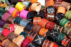 Leather bracelets for sale at outdoor market in Buenos Aires, Argentina. A sunny day at an outdoor market in Buenos Aires, Argentina. A stall is packed with wide stock photo