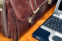 Leather Briefcase and Computer. This is an image of a leather briefcase and a laptop computer royalty free stock image