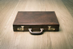 Leather briefcase on the floor Royalty Free Stock Photography