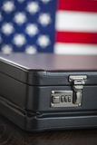 Leather Briefcase Resting on Table with American Flag Behind. Black Leather Briefcase Resting on Table with American Flag Behind Stock Photos