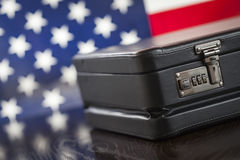 Leather Briefcase Resting on Table with American Flag Behind. Black Leather Briefcase Resting on Table with American Flag Behind Stock Image