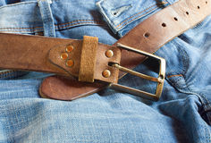 Leather brown belt with jeans Royalty Free Stock Image