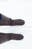 Leather Brown Boots in the snow. Top view Stock Photo