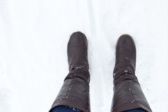 Leather Brown Boots in the snow. Top view Royalty Free Stock Photography