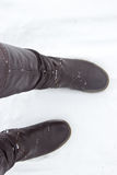 Leather Brown Boots in the snow. Top view Stock Photography