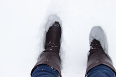 Leather Brown Boots in the snow. Top view Royalty Free Stock Photo