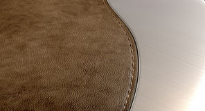 Leather Brown And Brushed Metal. A stitched piece of brown leather connected to a curved piece of brushed metal Royalty Free Stock Photo