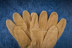 Leather brown construction gloves on scratched metallic surface Royalty Free Stock Photos
