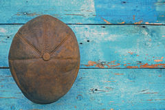Leather brown hat on wooden background Royalty Free Stock Photos