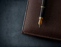 Leather brown notebook with fountain pen. Stock Photos