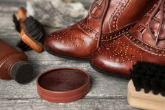 Leather shoes and shoe cleaning accessories Royalty Free Stock Images