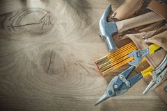 Leather building belt with construction tooling on wooden board Royalty Free Stock Photo
