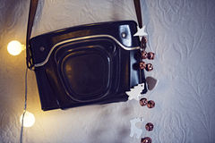 Leather camera case on wall Royalty Free Stock Photos