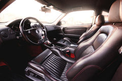 Leather car interior. Black leather interior with red stitching Stock Photos
