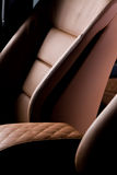 Leather car seat closeup photo Stock Images