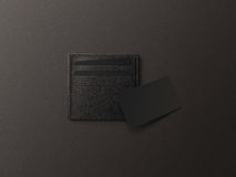 Leather card holder with blank black paper mock up . Stock Images