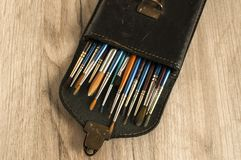 Leather case box with paint brushes closeup Stock Photo