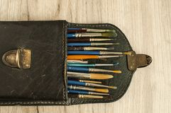 Leather case box with paint brushes closeup Stock Photography
