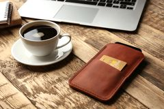 Leather Case With Mobile Phone, Laptop And Cup Stock Images
