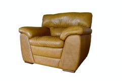 Brown leather chair. A large brown leather chair on a white background royalty free stock images