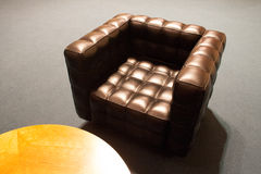Leather chair and table. Brown leather chair and a table in the Czech Parliament Royalty Free Stock Photography