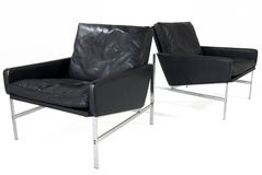 Leather chairs. Black leather arm chairs isolated on white Stock Photography