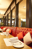 Leather chairs near mirror in steak restaurant Stock Image