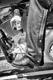 Leather Chaps. Side view of a motorcylist with leather chaps and boots royalty free stock photo