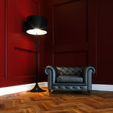 Leather classic armchair in new red interior with wooden parquet Stock Photos