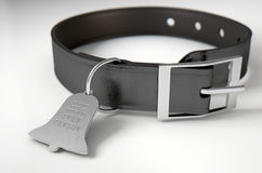 Leather Collar With Tag. A concept depicting pavlovian conditioning theory of a leather dog collar and a bell shaped identification tag showing ownership to ivan Stock Images
