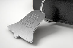 Leather Collar With Tag. A concept depicting pavlovian conditioning theory of a leather dog collar and a bell shaped identification tag showing ownership to ivan Stock Photos