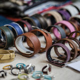 Leather and colored handmade bracelets. Leather bracelets and handmade rings stock images