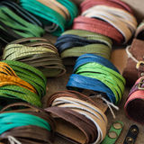 Leather and colored handmade bracelets. Leather bracelets and handmade rings stock photography