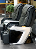 Leather comfortable massage chairs Stock Image