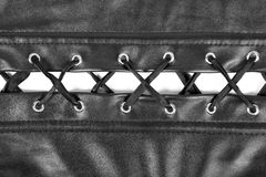 Leather corset lacing close-up isolated on white Stock Photography