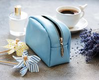 Leather cosmetic bag. With accessories on a stone background Royalty Free Stock Photos