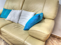 Leather couch with pillows in a living room in hdr Royalty Free Stock Photography