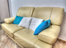 Leather couch with pillows in a living room in hdr Stock Image