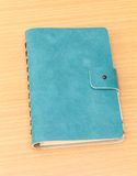 Leather cover of green notebook Stock Photography