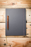 Leather cover note book. On wooden background Royalty Free Stock Photography