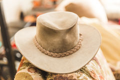 Leather Cowboy Hat on Couch Stock Photos