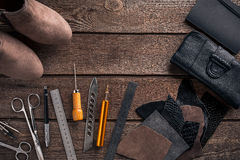 Leather craft or leather working. Leather working tools and cut out pieces of leather on work desk . Leather craft or leather working. Leather working tools and Stock Photos