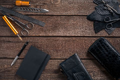 Leather craft or leather working. Leather working tools and cut out pieces of leather on work desk . Leather craft or leather working. Leather working tools and Stock Image