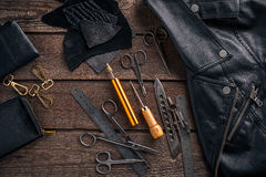 Leather craft or leather working. Leather working tools and cut out pieces of leather on work desk . Leather craft or leather working. Leather working tools and Royalty Free Stock Photo