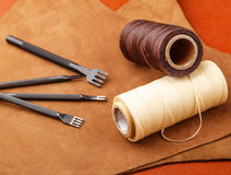 Leather craft tool. On the leather pieces royalty free stock images