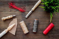 Leather craft workshop. Tools on dark wooden table background top view Stock Image