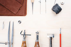 Leather crafting tools still life.. Work with a tool for leather and fabric Royalty Free Stock Photos