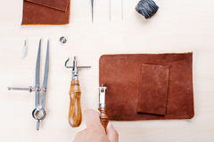 Leather crafting tools still life.. Work with a tool for leather and fabric Stock Photography