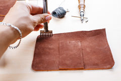 Leather crafting tools still life.. Work with a tool for leather and fabric Stock Photos