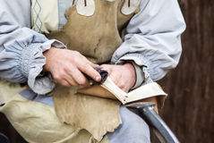 Leather craftsmen. Leather craftsmen making shoes by hand Stock Photography